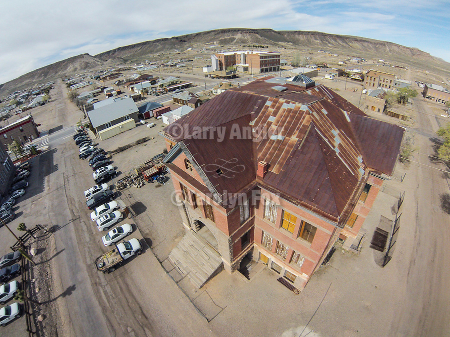 Historic Goldfield High School and downtown from the air, Nev.