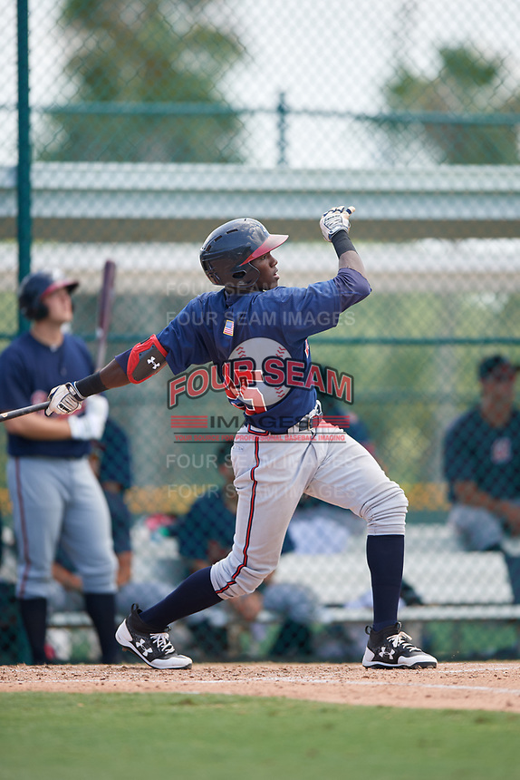 GCL Braves third baseman Jean Carlos Encarnacion (25) hits a home run during a game against the GCL Pirates on July 26, 2017 at Pirate City in Bradenton, Florida.  GCL Braves defeated the GCL Pirates 12-5.  (Mike Janes/Four Seam Images)