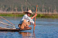 Myanmar, Burma.  Fisherman Preparing to Place his Net on the Lake Bottom, Inle Lake, Shan State.