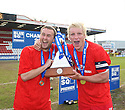 Joel Byrom and Mark Roberts of Stevenage Borough  celebrate with the Blue Square Premier championship trophy after the Blue Square Premier match between Stevenage Borough and York City at the Lamex Stadium, Broadhall Way, Stevenage on Saturday 24th April, 2010..© Kevin Coleman 2010 ..
