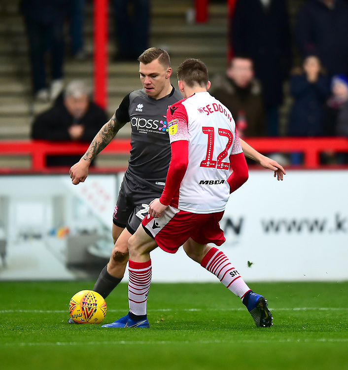 Lincoln City's Harry Anderson vies for possession with Stevenage's Steve Seddon<br /> <br /> Photographer Andrew Vaughan/CameraSport<br /> <br /> The EFL Sky Bet League Two - Stevenage v Lincoln City - Saturday 8th December 2018 - The Lamex Stadium - Stevenage<br /> <br /> World Copyright © 2018 CameraSport. All rights reserved. 43 Linden Ave. Countesthorpe. Leicester. England. LE8 5PG - Tel: +44 (0) 116 277 4147 - admin@camerasport.com - www.camerasport.com