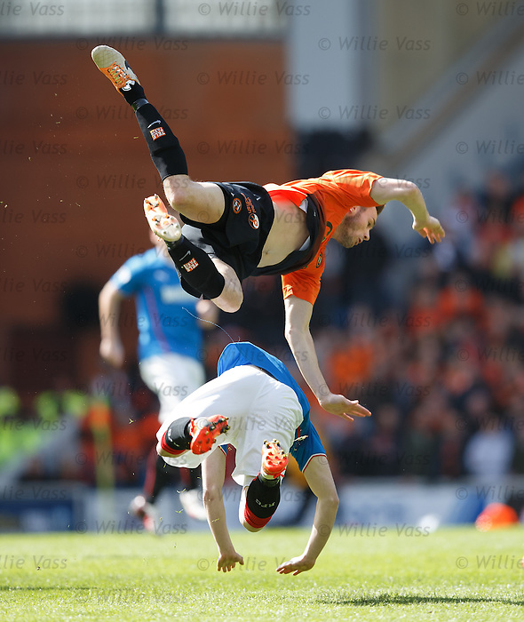 Keith Watson flies over Nicky Clark and crashes down to earth