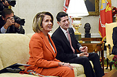 United States House Minority Leader Nancy Pelosi (Democrat of California) and US Speaker of the House Paul Ryan (Republican of Wisconsin) attend a meeting with US  President Donald J. Trump and Vice President Mike Pence in the Oval Office  of the White House , December 7, 2017 in Washington, DC.  <br /> Credit: Olivier Douliery / Pool via CNP