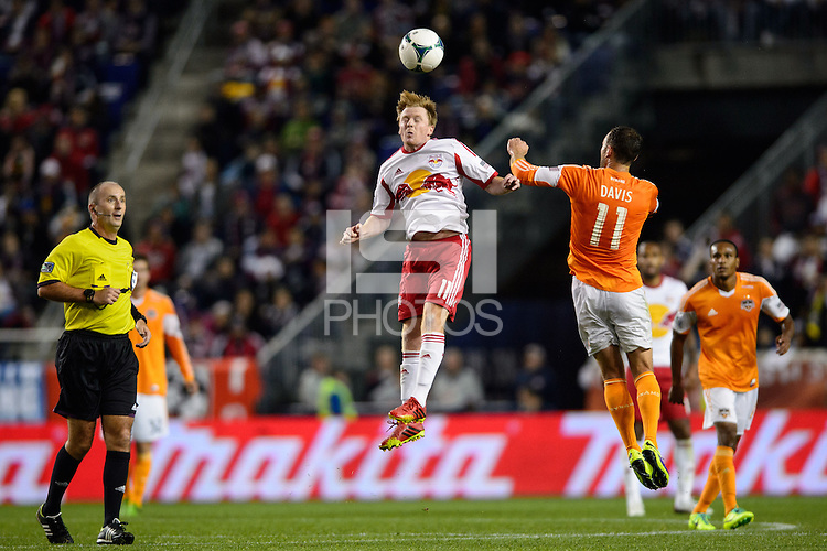 Dax McCarty (11) of the New York Red Bulls goes up for a header with Brad Davis (11) of the Houston Dynamo. The Houston Dynamo defeated the New York Red Bulls 2-1 (4-3 on aggregate) in overtime of the second leg of the Major League Soccer (MLS) Eastern Conference Semifinals at Red Bull Arena in Harrison, NJ, on November 6, 2013.