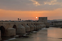The Roman bridge at sunset, built 1st century BC over the Guadalquivir river, and the Torre de la Calahorra, a fortified city gate, built in the 12th century by the Almohads, in Cordoba, Andalusia, Southern Spain. The historic centre of Cordoba is listed as a UNESCO World Heritage Site. Picture by Manuel Cohen