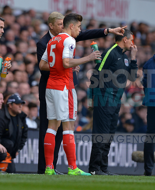 Arsene Wenger manager of Arsenal issues instructions to Gabriel Paulista of Arsenal during the English Premier League match at the White Hart Lane Stadium, London. Picture date: April 30th, 2017.Pic credit should read: Robin Parker/Sportimage
