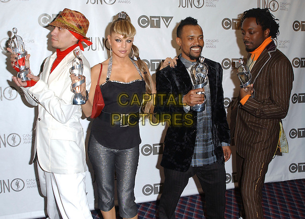 TABOO, FERGIE, APL.DE.AP & WILL.I.AM - BLACK EYED PEAS.The 35th Annual JUNO Awards held at the Halifax Metro Centre, Halifax, Nova Scotia, Canada. The JUNO Awards known as Canada's Music Awards are presented to Canada's best. .April 2nd, 2006.Photo: George Shepherd/AdMedia .Ref: GS/ADM.half length award trophy Stacy Ferguson hat brown pinstripe black white.www.capitalpictures.com.sales@capitalpictures.com.© Capital Pictures.