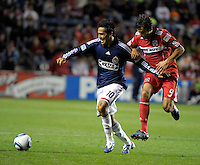 Chicago midfielder Baggio Husidic (9) tries to hold up Chivas midfielder Jesus Padilla (10).  The Chicago Fire tied Chivas USA 1-1 at Toyota Park in Bridgeview, IL on May 1, 2010.