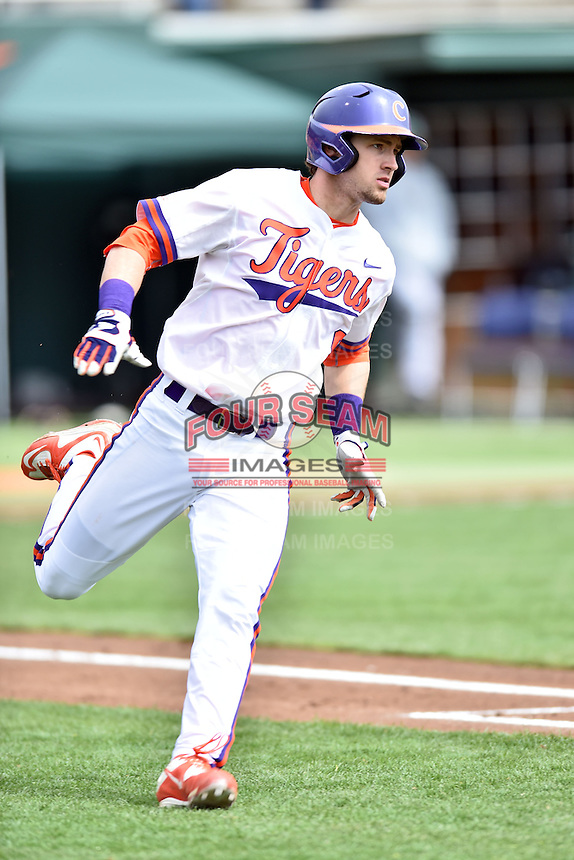 Clemson Tigers right fielder Steven Duggar (9) runs to first during a game against the Notre Dame Fighting Irish during game one of a double headers at Doug Kingsmore Stadium March 14, 2015 in Clemson, South Carolina. The Tigers defeated the Fighting Irish 6-1. (Tony Farlow/Four Seam Images)