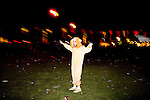 A man in a lion costume at the Coachella Valley Music and Arts Festival in Indio, California April 10, 2015. (Photo by Kendrick Brinson)