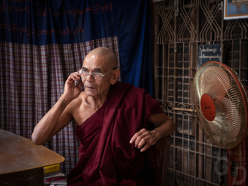 A Buddhist Monk on his cell phone at his Monastery in Mrauk U, Rakine State, Myanmar