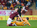 MOTHERWELL'S KEITH LASLEY GOES IN LATE ON HEARTS' ADRIAN MROWIEC