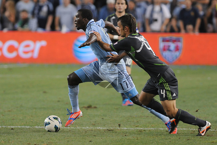 Sporting KC forward C.J. Sapong (17, left) is shadowed by Seattle Seahawks defender Patrick Ianni (4) in second half action. The Sporting KC defeated the Seattle Sounders on penalty kicks at the Lamar Hunt 2012 U.S. Open Cup Final which was played at LIVESTRONG Sporting Park in Kansas City, Kansas on Wednesday August 8, 2012.