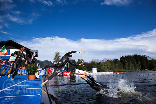 15 AUG 2010 - KITZBUEHEL, AUT - Competitors dive back into the water for the start of the second swim lap at the 2010 European Police Triathlon Championships (PHOTO (C) NIGEL FARROW)