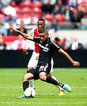 Nederland, Amsterdam, 7 oktober  2012.Seizoen 2012-2013.Eredivisie.Ajax-FC Utrecht.Anouar Kali van FC Utrecht in duel om de bal met Danny Hoessen van Ajax