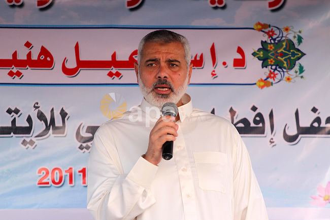 """Palestinian Prime Minister in Gaza Strip, Ismail Haniya delivers speech during his participation the collective meal """"Iftar"""" with the orphans in the holiest month of Ramadan, where sponsoring by the Interpal in Gaza city on Aug. 11, 2011. Photo by Mohammed Asad"""
