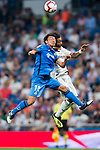 Gaku Shibasaki (L) of Getafe CF battles for the ball with Marcelo Vieira Da Silva of Real Madrid during the La Liga 2018-19 match between Real Madrid and Getafe CF at Estadio Santiago Bernabeu on August 19 2018 in Madrid, Spain. Photo by Diego Souto / Power Sport Images