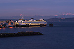 Ferry boat on Puget Sound at the Edmonds ferry terminal sunrise with Olympic Mountains.