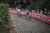 Race leaders Wout Van Aert (BEL/Crelan-Vastgoedservice) & Michael Vanthourenhout (BEL/Marlux-NapoleonGames) up the infamous Kapelmuur<br /> <br /> Brico-cross Geraardsbergen 2016<br /> U23 + Elite Mens race