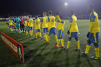 Players arrive on to the piitch during Haringey Borough vs AFC Wimbledon, Emirates FA Cup Football at Coles Park Stadium on 9th November 2018