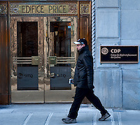 A man walks by the Caisse de depot et placement du Quebec (Quebec pension plan) headquarters in Price building in Quebec city March 23, 2009. CDP assets droped by $39.8 billion in 2008.