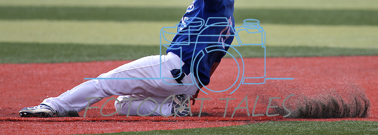 Western Nevada College's Jake Bennett slides safely into second against Mt. Hood Community Colllege at John L. Harvey Field in Carson City, Nev., on Friday, March 14, 2014. <br /> Photo by Cathleen Allison/Nevada Photo Source