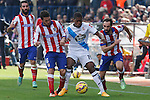 Atletico de Madrid´s Arda Turan, Koke and Juanfran and Deportivo de la Coruña´s Cavaleiro during 2014-15 La Liga match between Atletico de Madrid and Deportivo de la Coruña at Vicente Calderon stadium in Madrid, Spain. November 30, 2014. (ALTERPHOTOS/Victor Blanco)