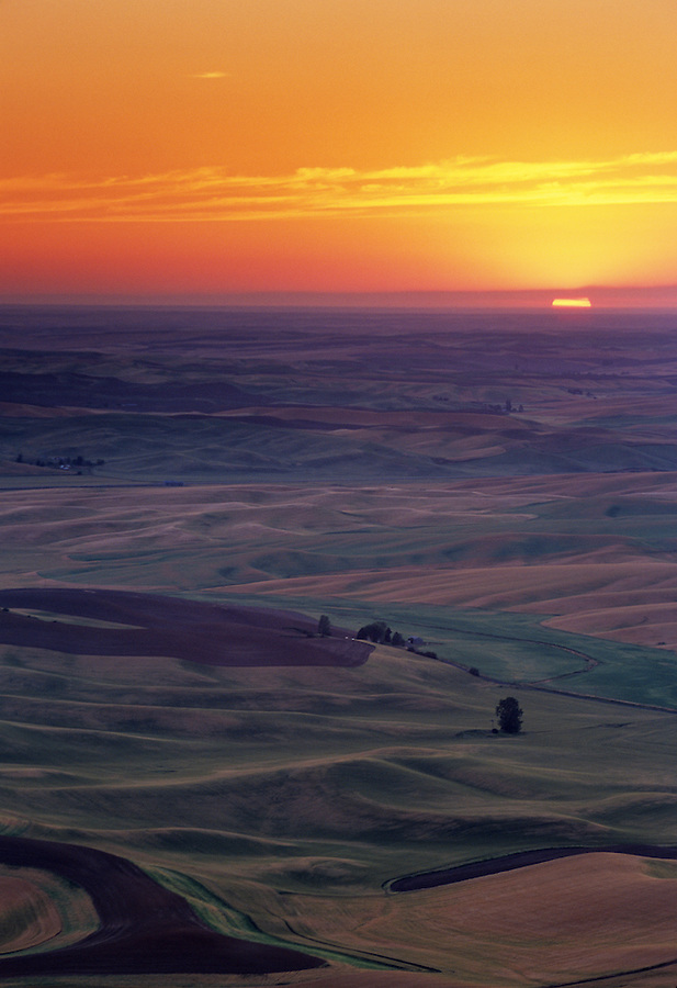 The warm, comforting light of a summer sunset as seen from Steptoe Butte in Eastern Washington State brings the day to an end.