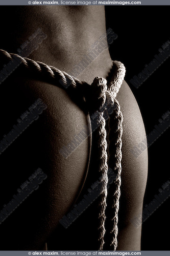 Woman with a rope knot on her back