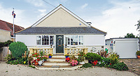 BNPS.co.uk (01202 558833)<br /> Pic: PurpleBricks/BNPS<br /> <br /> Hidden history...<br /> <br /> This £475,000 seaside cottage contains a charming secret – it's built around two Victorian railway carriages.<br /> <br /> The 19th century carriages were used as temporary housing for soldiers returning from the First World War when there was a shortage of homes.<br /> <br /> But many of them remained in place years later and had bricks and mortar built around them.<br /> <br /> And so from the street view they looked like normal houses but inside the main reception rooms were with the converted carriages.
