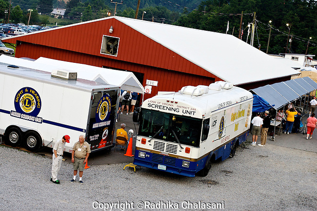 WISE, VIRGINIA-JULY 25: The Remote Area Medical (RAM) Expedition set up a vast mobile clinic for two and half days at the Virginia-Kentucky Fairgrounds using farm buildings, tents, converted trucks and buses July 25, 2009. RAM, operating in 5 states this year as well as overseas, provides free medical, dental and vision care to people in need. The vast majority of people receiving care at the two and half day event have no health insurance for their families or are underinsured.