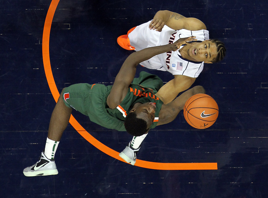 CHARLOTTESVILLE, VA- JANUARY 7: Durand Scott #1of the Miami Hurricanes shoots over Jontel Evans #1 of the Virginia Cavaliers during the game on January 7, 2012 at the John Paul Jones Arena in Charlottesville, Virginia. Virginia defeated Miami 52-51. (Photo by Andrew Shurtleff/Getty Images) *** Local Caption *** Jontel Evans;Durand Scott