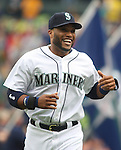 Seattle Mariners' second baseman Robinson Cano smiles during introductions before their game against theLos Angeles Angels in the  season home opener April 6, 2015 at Safeco Field in Seattle.  The Mariners beat the Angels 4-1.       ©2015. Jim Bryant Photo. ALL RIGHTS RESERVED.