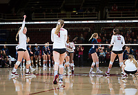 STANFORD, CA - December 1, 2018: Kathryn Plummer, Tami Alade, Meghan McClure, Audriana Fitzmorris at Maples Pavilion. The Stanford Cardinal defeated Loyola Marymount 25-20, 25-15, 25-17 in the second round of the NCAA tournament.