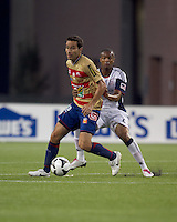 Monarcas Morelia forward Luis Gabriel Rey (18) dribbles as New England Revolution defender Darrius Barnes (25) defends. Monarcas Morelia defeated the New England Revolution, 2-1, in the SuperLiga 2010 Final at Gillette Stadium on September 1, 2010.