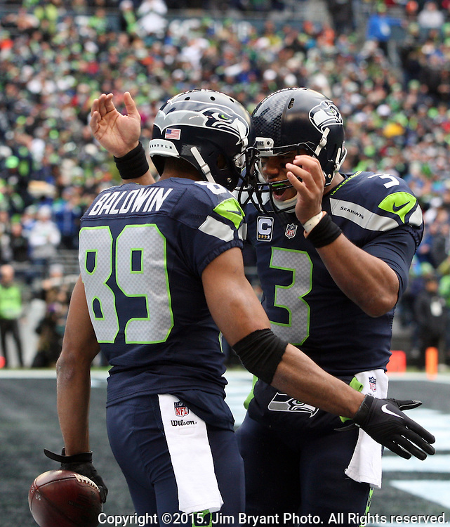 Seattle Seahawks quarterback Russell Wilson (3) celebrates in the end zone with wide receiver Doug Baldwin (89) Cleveland Browns at CenturyLink Field in Seattle, Washington on December 20, 2015. The Seahawks clinched their fourth straight playoff berth in four seasons by beating the Browns 30-13.  ©2015. Jim Bryant Photo. All Rights Reserved.