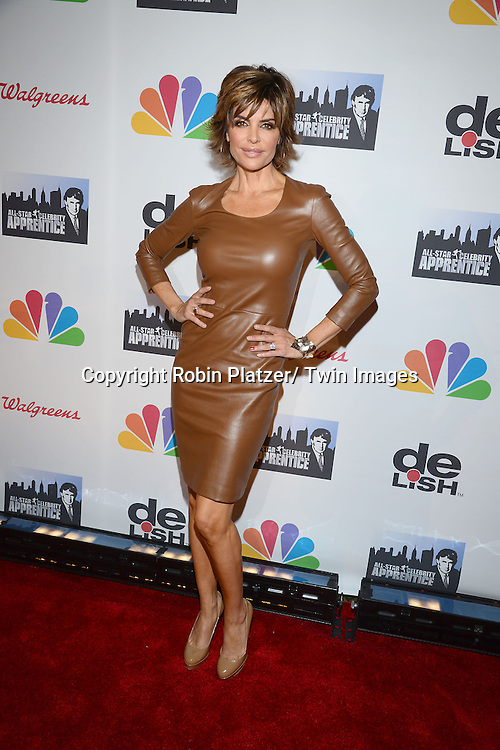 8f9177f316de Lisa Rinna in beige leather The Row dress attends the