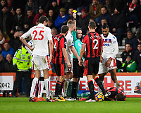 Referee Paul Tierney  gives a yellow card to Eric Maxim Choupo-Moting of Stoke City right as Ryan Fraser of AFC Bournemouth lies on the floor during AFC Bournemouth vs Stoke City, Premier League Football at the Vitality Stadium on 3rd February 2018