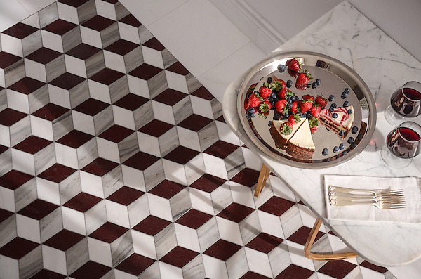 Euclid Grand, a hand-cut mosaic shown in polished Red Lake, polished Afyon White, and honed Horizon, is part of the Illusions® collection by New Ravenna.