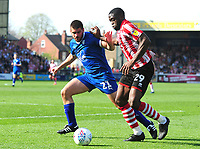 Lincoln City's John Akinde vies for possession with Tranmere Rovers' Evan Gumbs<br /> <br /> Photographer Andrew Vaughan/CameraSport<br /> <br /> The EFL Sky Bet League Two - Lincoln City v Tranmere Rovers - Monday 22nd April 2019 - Sincil Bank - Lincoln<br /> <br /> World Copyright © 2019 CameraSport. All rights reserved. 43 Linden Ave. Countesthorpe. Leicester. England. LE8 5PG - Tel: +44 (0) 116 277 4147 - admin@camerasport.com - www.camerasport.com