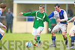 Castleisland's Sean Brosnan breaks away from the Ballina defenders during their FAI cup clash in Tralee on Sunday