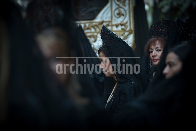 VALLADOLID, APRIL, 17, 2014. Women dressed with the traditional mantilla takes part in a Holy Week procession in Valladolid, Spain, Thursday, April 17, 2014. Holy week in Valladolid is known for the more than 20 sculptures, from the National Museum of Esculptur, which are said as a street museum, and the more than 19 brotherhoods which take part in differents processions during the week. Patricio Realpe/Archivolatino