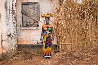 Port Loko, Sierra Leone, 2015. Seventy percent of women in Sierra Leone live on less than one dollar a day. Women without financial support, like Kadatu here selling mangos, earn very little as they depend on unstable seasonal trades.