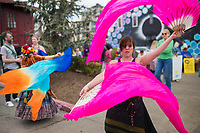 NWA Democrat-Gazette/CHARLIE KAIJO Kady Bright of Fayetteville twirls fans during the Parade for Peace, Sunday, March 18, 2018 that started at the Walton Art Center and ended at the Town Center in Fayetteville. <br /><br />The Arkansas Poor People&acirc;&euro;&trade;s Campaign, the OMNI Center and Arkansas Nonviolence Alliance held a Parade for Peace. The parade featured multiple floats, dancing troops and large art projects.