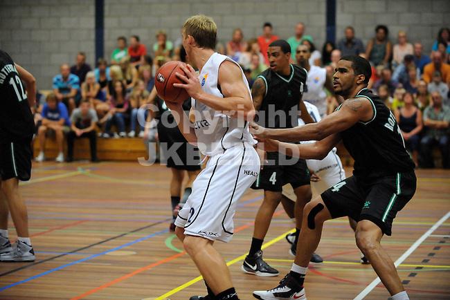 VEENDAM - Basketbal, Gasterra Flames - Rotterdam, voorbereiding seizoen 2013-2014, 06-09-2013,    Flames speler Ross Bekkering zoekt ruimte