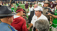 Hawgs Illustrated/Ben Goff<br /> Chad Morris, Arkansas head coach, and Jimbo Fisher, Texas A&M head coach, shake hands after the game Saturday, Sept. 29, 2018, during the Southwest Classic at AT&T Stadium in Arlington, Texas.
