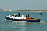 Pictured:  The vesssel pictured at sea en route to Yarmouth for the Old Gaffers festival.<br /> <br /> An historic 100 year old Royal Navy steam ship has finally been returned to its former glory after a painstaking restoration process.<br /> <br /> The 50ft-long Steam Pinnace 199 is believed to be the last remaining boat of its type in operational service.<br /> <br /> For years, the significance of the boat, which was built in 1911, was lost on various owners and it languished at the side of the Thames for more than 20 years as a static houseboat.<br /> <br /> Her steam engine was even replaced by a petrol engine.<br /> <br /> However, before the vessel disappeared forever beneath a Thames mud bank, she was recognised for the proud little ship she once was and rescued by a group of volunteers, who called themselves Group 199.   SEE OUR COPY FOR DETAILS.<br /> <br /> Please byline: Martin Marks/Solent News<br /> <br /> © Martin Marks/Solent News & Photo Agency<br /> UK +44 (0) 2380 458800