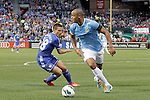 23 May 2013:  Vincent Kompany (4)(BEL) of Manchester City moves the ball around Cesar Azpilicueta (28)(ESP) of Chelsea.  Chelsea F.C. was defeated by Manchester City 3-4 at Busch Stadium in Saint Louis, Missouri, in a friendly exhibition soccer match.