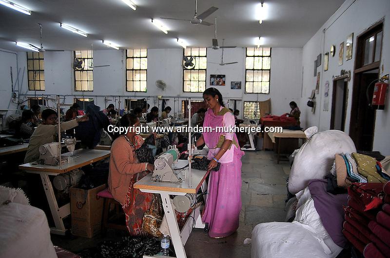 Women working athe main workshop of 'Sadhna' in Udaipur, Rajasthan, India. 24.1.2011. Arindam Mukherjee