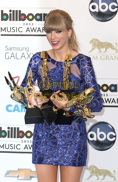 Taylor Swift.2013 Billboard Music Awards Press Room at MGM Grand, Las Vegas, NV., USA..May 19th, 2013.half length blue dress beads beaded smiling sequins sequined trophies trophy winner    .CAP/ADM/MJT.© MJT/AdMedia/Capital Pictures